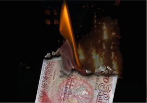 Burning £50 notes in front of the poor